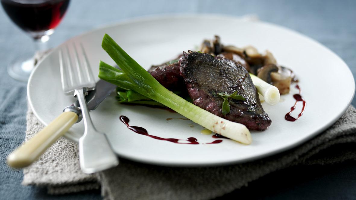 Pigeon breast with red wine gravy, roast leeks and wild mushrooms