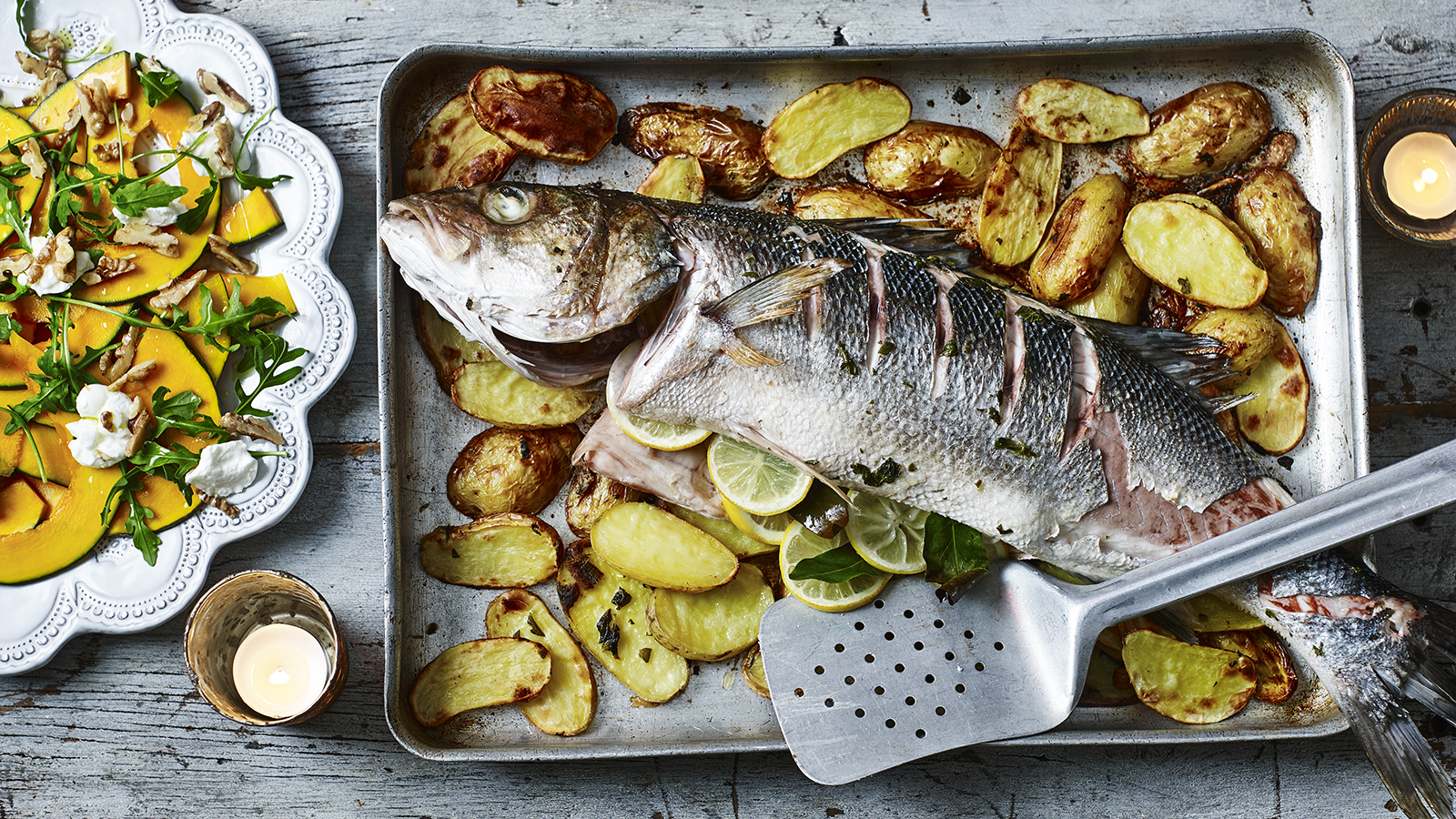 Whole Baked Sea Bass On Potatoes Recipe Bbc Food